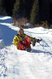 Woman ride on snow road Stock Photo