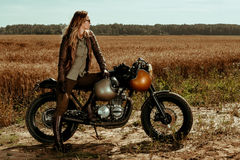 Woman rider with his vintage custom made cafe racer stock photography