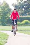 Woman rides a bicycle Royalty Free Stock Photography