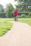 Woman rides a bicycle Royalty Free Stock Photos