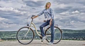 Woman rides bicycle sky background. Benefits of cycling every day. Keep fit shape easy with regular cycling. Girl ride. Cruiser bicycle. Health benefits of royalty free stock images