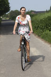 Woman rides a bike Royalty Free Stock Photography