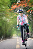 Woman rides bike in speedy on countryside Royalty Free Stock Photo