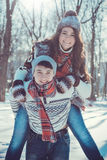 Woman rides on her boyfriend`s back Royalty Free Stock Photo