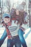 Woman rides on her boyfriend`s back. In the park Stock Photos