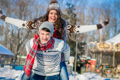 Woman rides on her boyfriend`s back Stock Photography