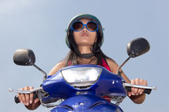 A woman rides on a motorcycle Royalty Free Stock Photo