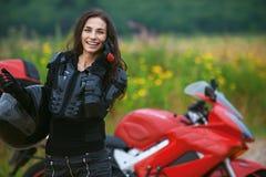 Woman rides nice bike Royalty Free Stock Photography