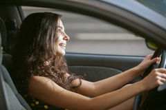 Woman rides nice car. Young woman with nice car on road stock images