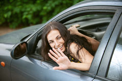 Woman rides nice car Royalty Free Stock Photography