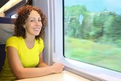 Woman rides in speed train near window Stock Image