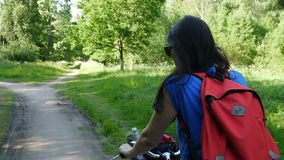 A woman rides on summer Park Bicycle stock video footage
