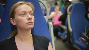Woman rides the train. Tired woman rides the train stock footage
