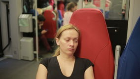 Woman rides the train. Tired woman rides the train stock video