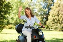 Woman riding Royalty Free Stock Image