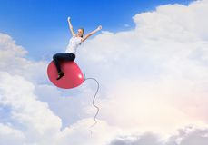 Woman riding balloon Stock Images