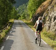 Woman riding on bicycle 2. Woman riding on bicycle - on mountain road stock photography