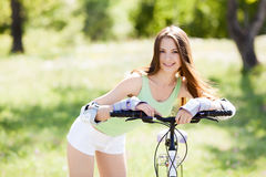 Woman riding a bicycle Royalty Free Stock Image