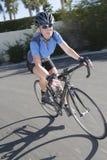 Woman Riding Bicycle Stock Photos