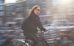 Woman Riding Bicycle Royalty Free Stock Photos
