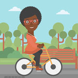 Woman riding bicycle. Royalty Free Stock Photos