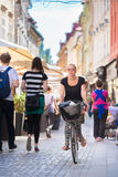 Woman riding bicycle in city center. Royalty Free Stock Photos