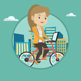 Woman riding bicycle in the city. Stock Image