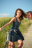 Woman riding bicycle in country Stock Image