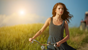 Woman riding bicycle in country Royalty Free Stock Image