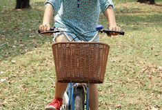 Woman riding bicycle Stock Images