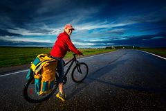 Woman riding the bicycle Stock Images