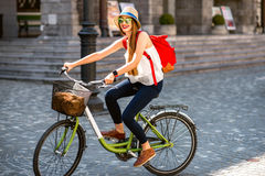 Woman riding a bicycle in the old european city stock photography