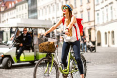 Woman riding a bicycle in the old european city royalty free stock photo