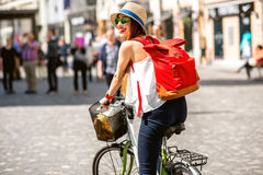 Woman riding a bicycle in the old european city stock images