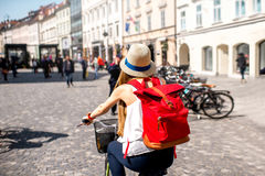 Woman riding a bicycle in the old european city royalty free stock image