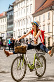 Woman riding a bicycle in the old european city stock photo