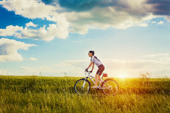 Woman is riding bicycle outside. Happy Young Woman riding bicycle outside. Healthy Lifestyle Stock Photography