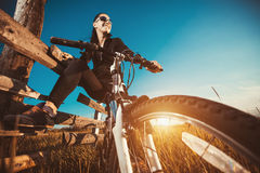 Woman is riding bicycle outside Stock Image