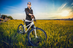 Woman is riding bicycle outside Royalty Free Stock Photography