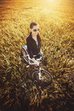 Woman is riding bicycle outside. top view Royalty Free Stock Photo