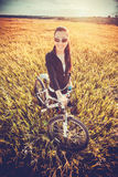 Woman is riding bicycle outside. top view Stock Image