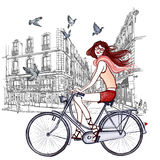 Woman riding a bicycle in Paris Royalty Free Stock Photo