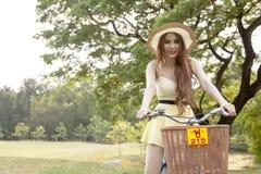 Woman riding a bicycle Stock Photos