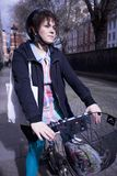 Woman Riding Bicycle On Street Royalty Free Stock Images