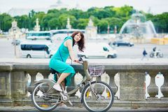 Woman riding a bicycle on a street of Paris Royalty Free Stock Images
