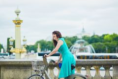 Woman riding a bicycle on a street of Paris Royalty Free Stock Image