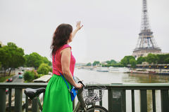 Woman riding a bicycle on a street of Paris Royalty Free Stock Photos