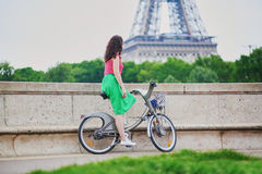 Woman riding a bicycle on a street of Paris Stock Images
