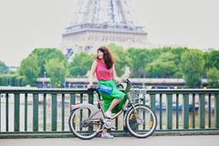 Woman riding a bicycle on a street of Paris Stock Image