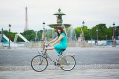 Woman riding a bicycle on a street of Paris Royalty Free Stock Photo